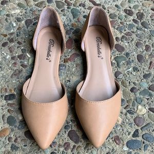 Breckelle's nude, almond-toed flats